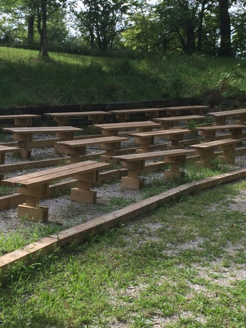 Outdoor Education Seating comprise the amphitheater.  The benches are in four rows with about 7 benches per row. These benches were built by a Boy Scout for his Eagle Scout project.